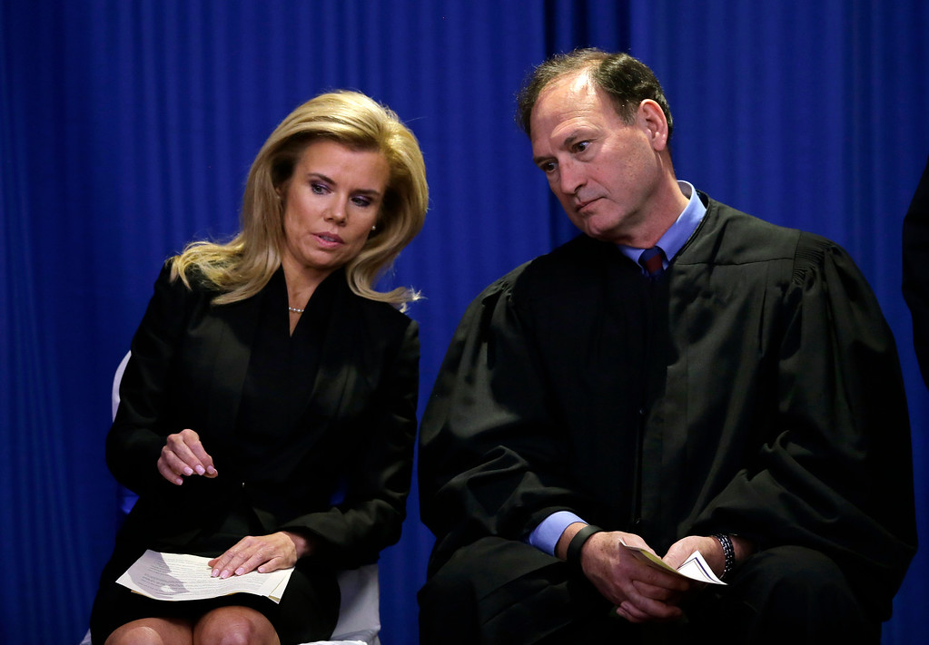 . Hamilton Township Mayor Kelly A. Yaede, left, and U.S. Supreme Court Justice Samuel Alito talk together before he administered the oath of office to her Friday, Jan. 1, 2016, in Hamilton Township, N.J. Yaede won her first full, four-year term last November. She has led the Mercer County community since November 2012, when she took over for former Mayor John Bencivengo after he resigned following his conviction on corruption charges. Alito was born in Trenton and raised in Hamilton. (AP Photo/Mel Evans)