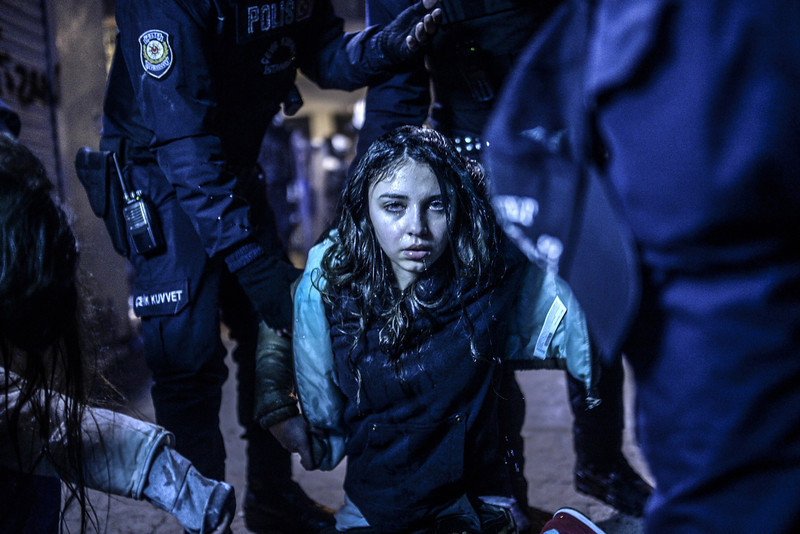 . A young girl is pictured after she was  wounded during clashes between riot-police and protestors after the funeral of Berkin Elvan, the 15-year-old boy who died from injuries suffered during last year\'s anti-government protests, in Istanbul on March 12, 2014. Riot police fired tear gas and water cannon at protestors in the capital Ankara, while in Istanbul, crowds shouting anti-government slogans lit a huge fire as they made their way to a cemetery for the burial of Berkin Elvan. (BULENT KILIC/AFP/Getty Images)