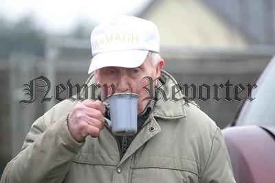 Eamon Maginness enjoys a cup of hot tea. 06W11N81