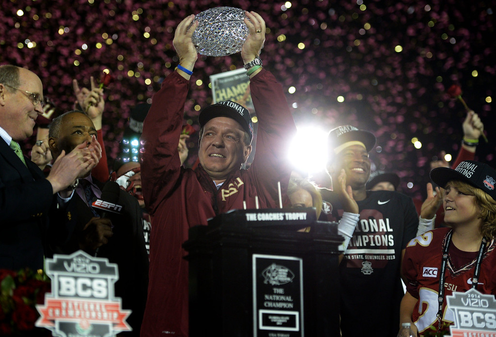 . Florida State head coach Jimbo Fisher holds-up the championship trophy after defeating Auburn 34-31 during the BCS National Championship game at the Rose Bowl in Pasadena, Calif., on Monday, Jan. 6, 2014. 