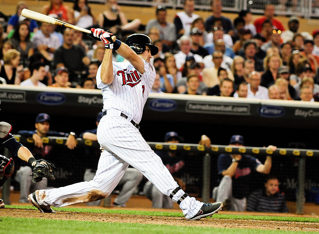 . Minnesota Twins catcher Joe Mauer hits a single in the 8th inning to score the go ahead run. (Pioneer Press: Ben Garvin)