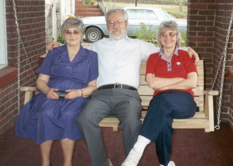 Tom Jacquie Ruth on porch swing.jpg
