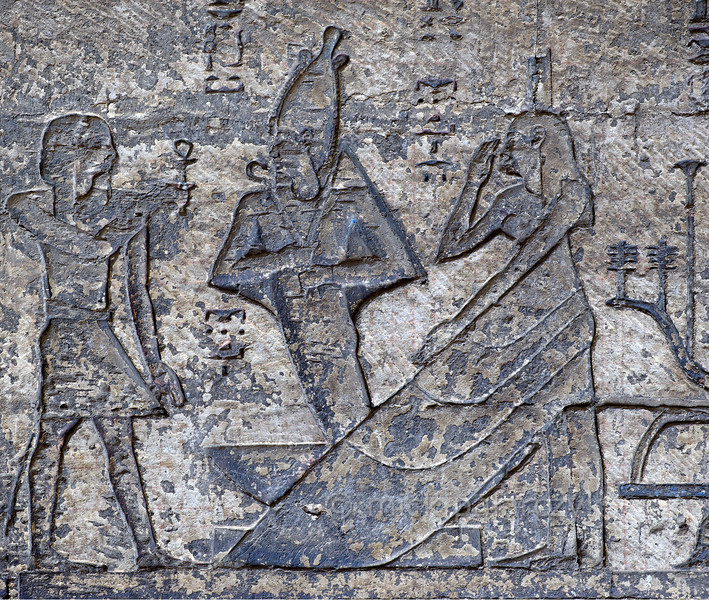 [EGYPT 29620] 'Resurrection of Osiris at Dendera.'  A relief in the northernmost of the western Osiris chapels on the roof of the Hathor Temple at Dendera shows a winged Isis (on the right) watching over the resurrection of her husband Osiris. The chapel was used during the Osiris Festival in the month khoiak, which celebrated the resurrection of Osiris. This part of the Dendera Temple was built during the later Ptolemaic period (first century BC). Photo Mick Palarczyk.