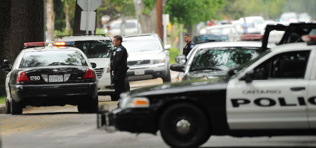 . (5-5-13)--ONTARIO--METRO--Ontario Police officers search for an allegedly armed man in the 100 block East Harvard Place near Euclid Avenue Sunday May 5, 2013 in Ontario.LaFonzo Carter/ Staff Photographer