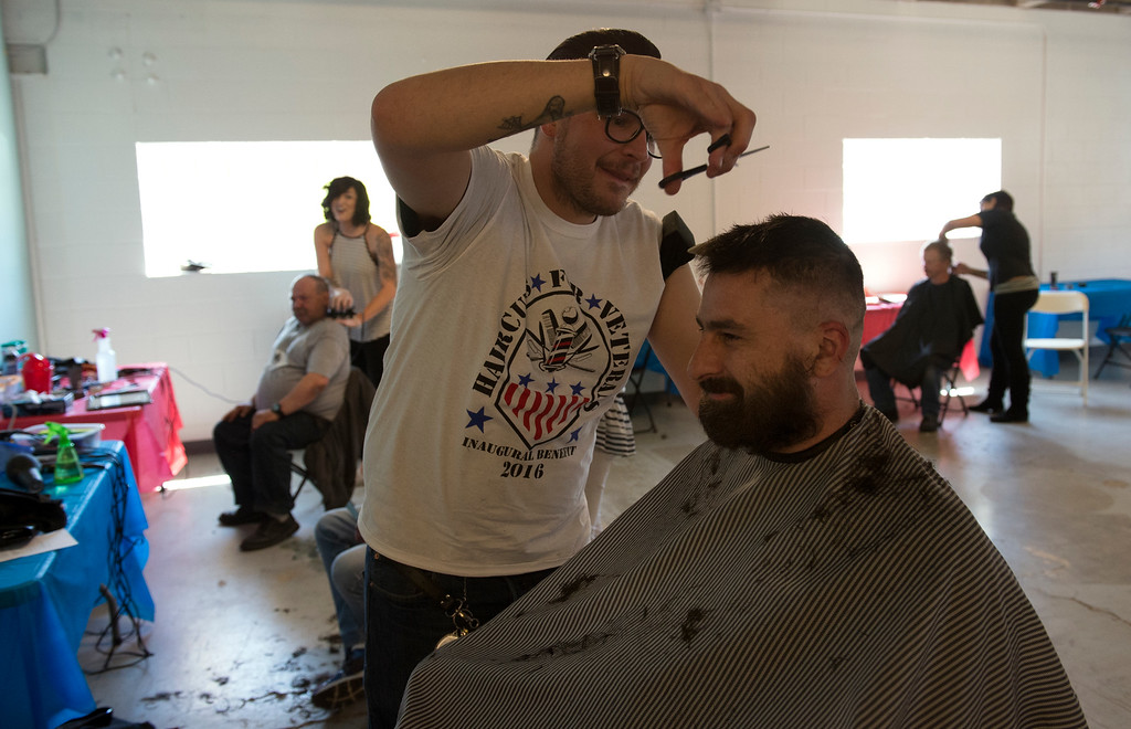 ". DENVER, CO - APRIL 25: Donating his time, Riley Bigelow, left, gives Army veteran Thomas Barta a cut and beard trim. Volunteers of America along with other organizations, hosts a ""Haircuts for Veterans\"" event at the Bill Daniels Veteran Service Center in Denver on Monday, April 25, 2016. Along with the haircuts, veterans have access to housing service assistance, assistance with job and education opportunities, as well as a hot meal. (Photo by Kathryn Scott Osler/The Denver Post)"