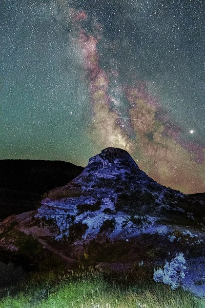 Soda butte spewing out milky way galaxy like volcano in yellowstone national park in wyoming