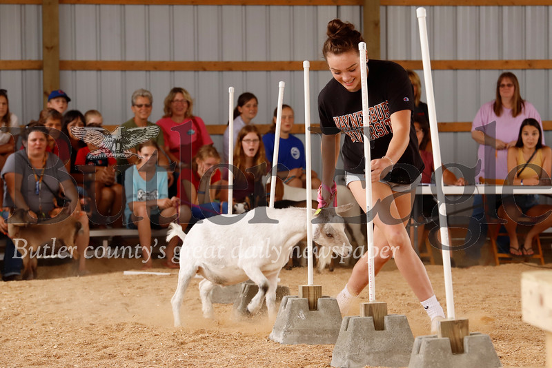 Madison Myers, 16, of Mars leads her goat through the slalom obstacle at the Butler Farm Show Wednesday. Seb Foltz/Butler Eagle