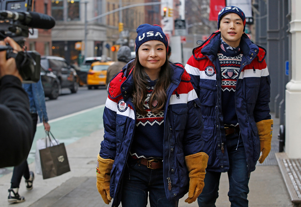 . Ice dancing pair and sister and brother Maia and Alex Shibutani, who will participate in the upcoming winter Olympics in Pyeongchang, South Korea, model Team USA\'s opening ceremony uniforms for a cameraman on the street outside Polo Ralph Lauren\'s Prince Street store, Monday, Jan. 22, 2018, in New York. (AP Photo/Kathy Willens)