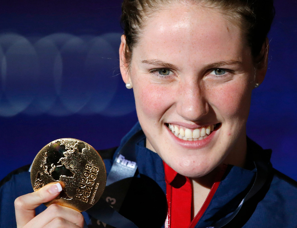 . Missy Franklin of the United States smiles as she holds the gold medal she won in the Women\'s 200m backstroke final at the FINA Swimming World Championships in Barcelona, Spain, Saturday, Aug. 3, 2013. (AP Photo/Daniel Ochoa de Olza)