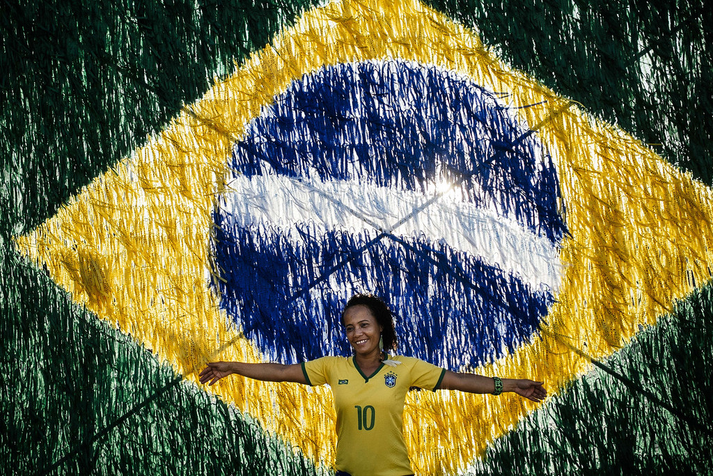 . A woman poses in front a Brazilian flag in a street in Salvador on June 17, 2014, prior the match opposing Brazil to Mexico during the 2014 FIFA World Cup. DIMITAR DILKOFF/AFP/Getty Images