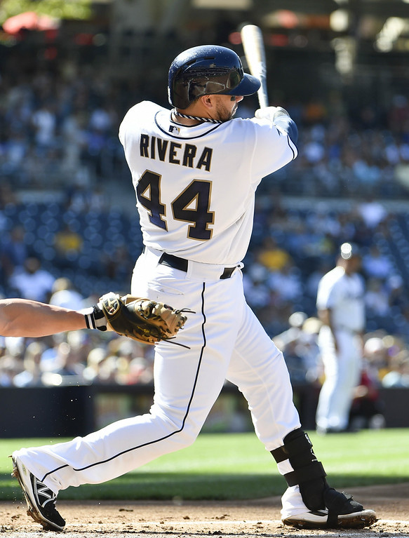 . SAN DIEGO, CA - AUGUST 13:  Rene Rivera #44 of the San Diego Padres hits an RBI single during the first inning of a baseball game against the Colorado Rockies at Petco Park on August 13, 2014 in San Diego, California.  (Photo by Denis Poroy/Getty Images)