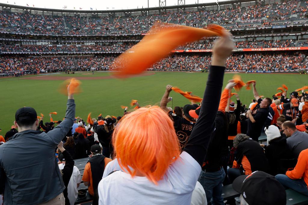 . San Francisco Giants fans cheer before Game 4 of baseball\'s World Series between the Kansas City Royals and the San Francisco Giants on Saturday, Oct. 25, 2014, in San Francisco. (AP Photo/Charlie Riedel)