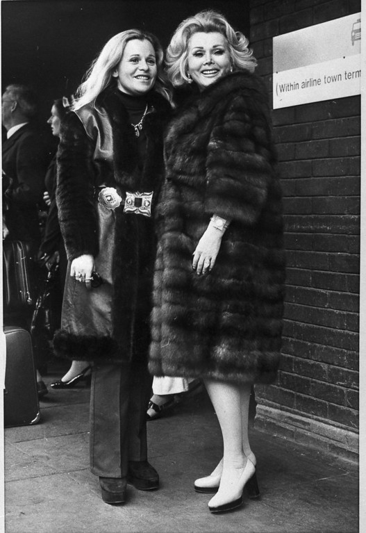 . Zsa Zsa Gabor, right, and her daughter Francesca Hilton arrive at London\'s Heathrow Airport, June 1, 1973, to appear on a television talk show with Diana Dors. (AP Photo/Press Association)