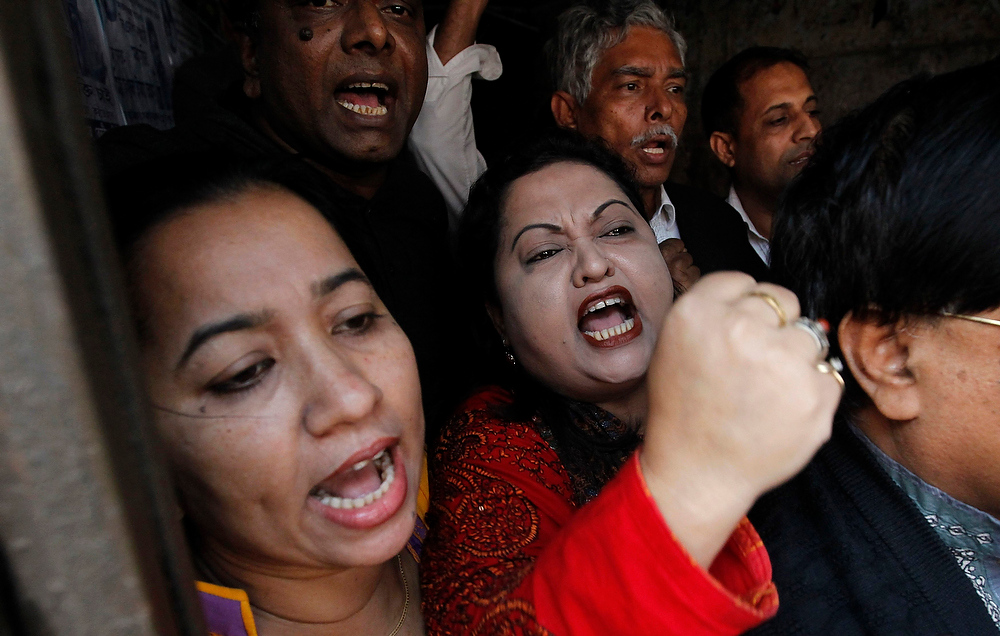 Description of . Activists of Bangladesh Nationalist Party shout slogans in front of their party office during a strike in Dhaka December 13, 2012. Bangladesh's opposition alliance, led by former Prime Minister Begum Khaleda Zia, called for a eight-hours nationwide strike, two days after another violent strike, to press home its demand for immediate release of its acting secretary general Mirza Fakhrul Islam Alamgir and in protest against the killings and arrests of opposition activists during their Sunday's road blockade program, local media reported.  REUTERS/Andrew Biraj