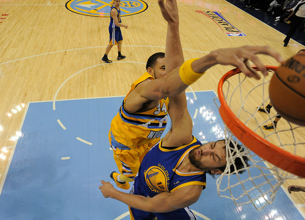 . DENVER, CO. - APRIL 20: Denver Nuggets center JaVale McGee (34) dunks over Golden State Warriors center Andrew Bogut (12). The Denver Nuggets took on the Golden State Warriors in Game 1 of the Western Conference First Round Series at the Pepsi Center in Denver, Colo. on April 20, 2013. (Photo by John Leyba/The Denver Post)
