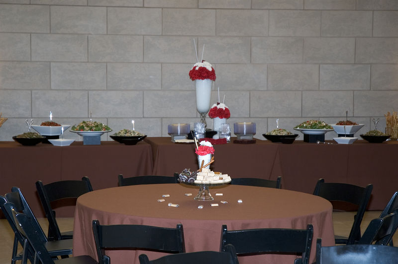 Buffet table behind table for adults