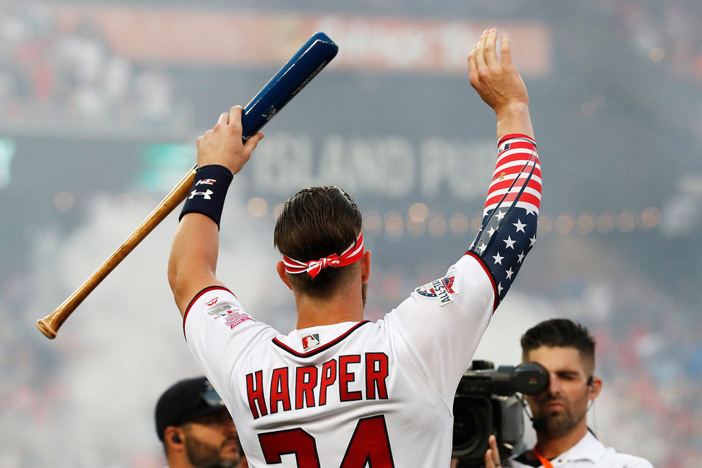 . Washington Nationals Bryce Harper (34) waves to fans during the MLB Home Run Derby, at Nationals Park, Monday, July 16, 2018 in Washington. The 89th MLB baseball All-Star Game will be played Tuesday. (AP Photo/Alex Brandon)