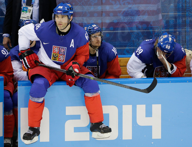 . Czech Republic forward Jaromir Jagr sits on the boards waiting to enter the game during the third period of men\'s quarterfinal hockey game against the United States in Shayba Arena at the 2014 Winter Olympics, Wednesday, Feb. 19, 2014, in Sochi, Russia. (AP Photo/David J. Phillip )
