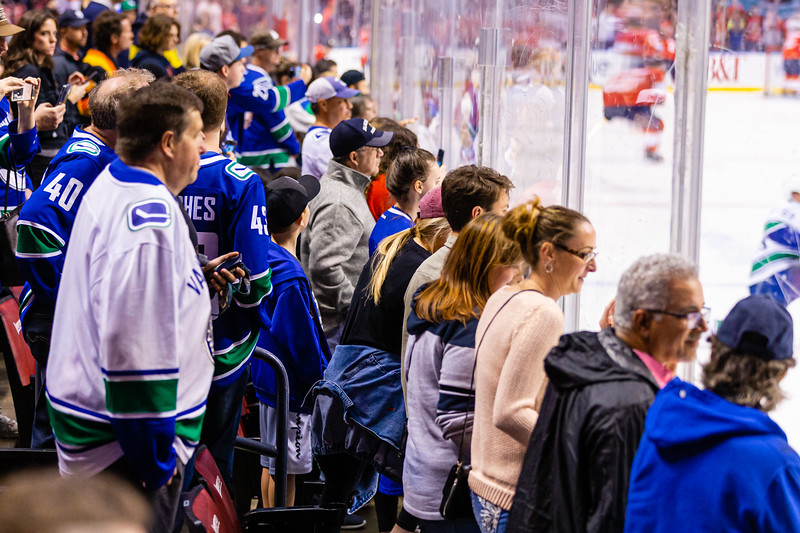Canuck fans crowd the glass to watch the pregame warmup skate at the BB&T Center on Thursday, January 9, 2020, where the Florida Panther hosted the Vancouver Canucks. The Panthers would go on to beat the Canucks 5-2.  [JOSEPH FORZANO/palmbeachpost.com]
