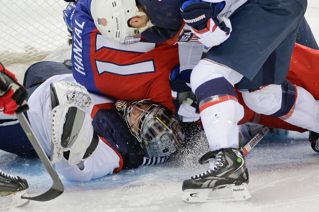 . USA goaltender Jonathan Quick is crushed under Czech Republic forward Martin Hanzal during the third period of men\'s quarterfinal hockey game in Shayba Arena at the 2014 Winter Olympics, Wednesday, Feb. 19, 2014, in Sochi, Russia. (AP Photo/David J. Phillip )