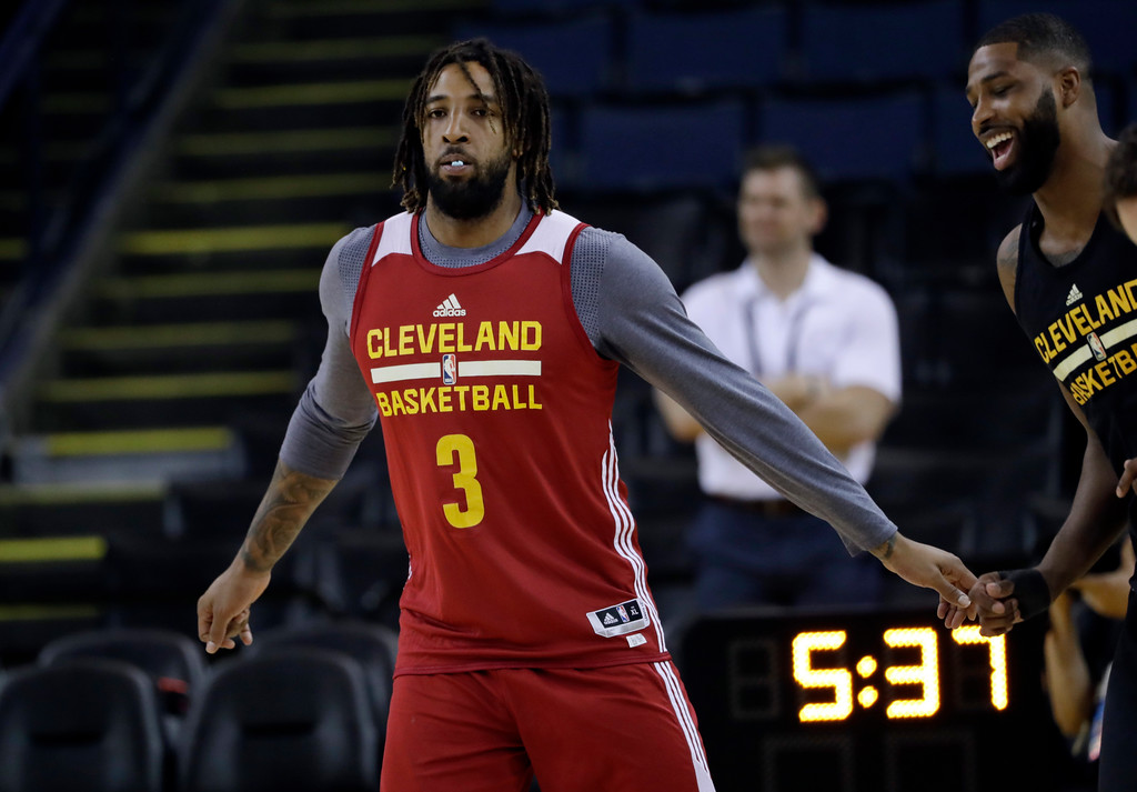 . Cleveland Cavaliers\' Derrick Williams (3) warms up during an NBA basketball practice, Wednesday, May 31, 2017, in Oakland, Calif. The Cavaliers face the Golden State Warriors in Game 1 of the NBA Finals on Thursday in Oakland. (AP Photo/Marcio Jose Sanchez)