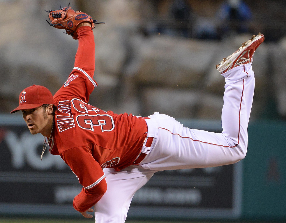 . Los Angeles Angels starting pitcher C.J. Wilson throws to the plate against the New York Yankees in the second inning of a baseball game at Anaheim Stadium in Anaheim, Calif., on Tuesday, May 6, 2014.  (Keith Birmingham Pasadena Star-News)
