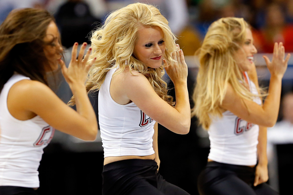 . Louisville Cardinals cheerleaders perform during the second round of the 2014 NCAA Men\'s Basketball Tournament at Amway Center on March 20, 2014 in Orlando, Florida.  (Photo by Kevin C. Cox/Getty Images)
