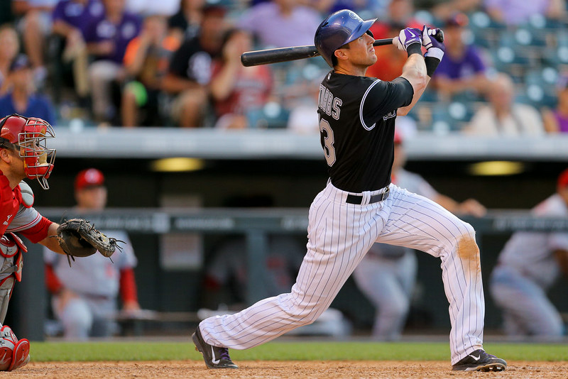 . Drew Stubbs #13 of the Colorado Rockies hits a walk-off, three-run home run during the ninth inning against the Cincinnati Reds at Coors Field on August 17, 2014 in Denver, Colorado. The Rockies defeated the Reds 10-9. (Photo by Justin Edmonds/Getty Images)