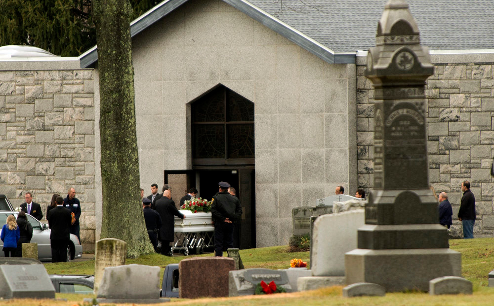 Description of . The casket of James Mattioli, 6, is moved to the mausoleum at St John's Roman Catholic Cemetery December 18, 2012 in Darien, Connecticut. Mattioli is one of 20 children killed at the Sandy Hook Elementary School. Lawmakers are under mounting pressure to address the issue of gun laws in the aftermath of last week's school massacre in Newtown, Connecticut.  AFP PHOTO/DON EMMERT/AFP/Getty Images