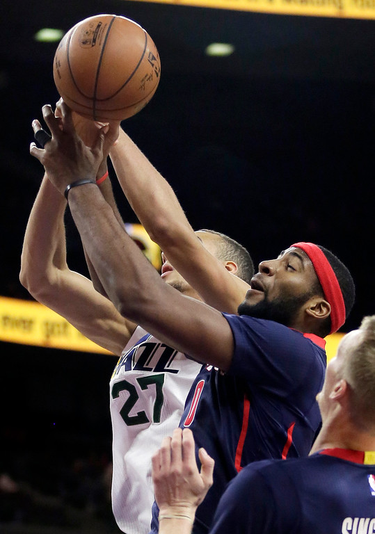 . Utah Jazz\'s Rudy Gobert (27) and Detroit Pistons\' Andre Drummond (0) reach for a rebound during the first half of an NBA basketball game Sunday, Nov. 9, 2014, in Auburn Hills, Mich.  (AP Photo/Duane Burleson)