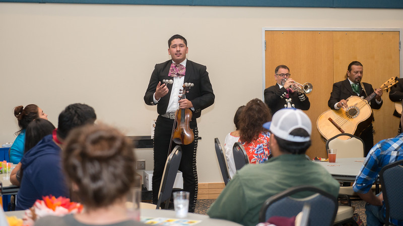 Students and faculty attending the P.A.S.S Hispanic Heritage Month event and were treated to mariachi music by the Mariachi Mexicanisimo group.