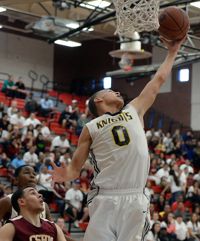 . Bishop Montgomery \'s Christian Oshita (0) rebounds against Cantwell in the first half of a CIF Southern California Regional Division IV basketball game at Colony High School in Ontario, Calif., on Saturday, March 22, 2014.  (Keith Birmingham Pasadena Star-News)