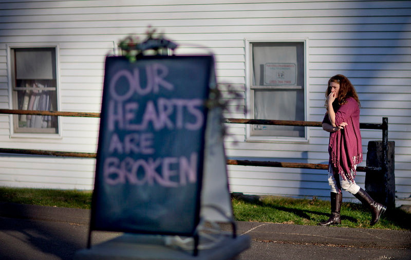 . Shop owner Tamara Doherty paces outside her store just down the road from Sandy Hook Elementary School, Saturday, Dec. 15, 2012, in Newtown, Conn. The massacre of 26 children and adults at the school elicited horror and soul-searching around the world even as it raised more basic questions about why the gunman, 20-year-old Adam Lanza, would have been driven to such a crime and how he chose his victims. (AP Photo/David Goldman)