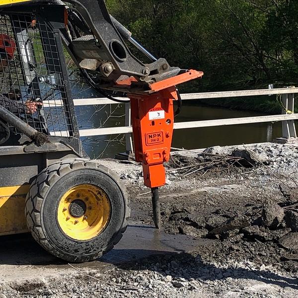 NPK PH2 hydraulic hammer on skidsteer - CATCO construction, Buffalo, NY, Monroe Tractor  5-20..jpeg