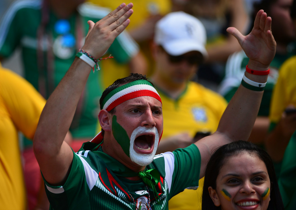 . A Mexican fan reacts prior to a Round of 16 football match between Netherlands and Mexico at Castelao Stadium in Fortaleza during the 2014 FIFA World Cup on June 29, 2014.   AFP PHOTO/ YURI CORTEZ
