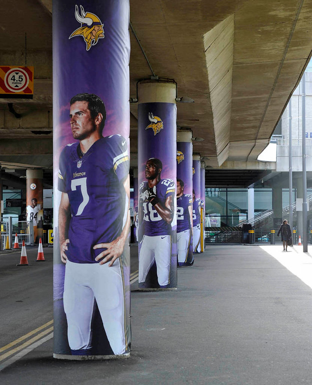 . Images of Vikings players are displayed  at Wembley Stadium in London Tuesday. (NFL: Sean Ryan)