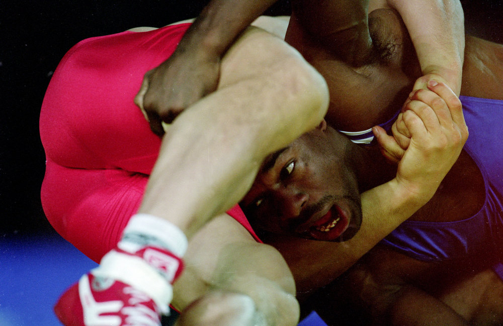 Description of . Filiberto Azcuy of Cuba puts the moves on Sang-Pil Son of Korea in the Mens Greco Roman Wrestling 69kg Event during the Sydney 2000 Olympic Games at the Exhibitin Hall 1&2  in Sydney, Australia. Scott Barbour/AUS  /Allsport