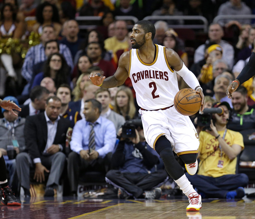 . Cleveland Cavaliers\' Kyrie Irving drives the ball downcourt during an NBA basketball game against the Portland Trail Blazers Wednesday, Jan. 28, 2015, in Cleveland. (AP Photo/Tony Dejak)