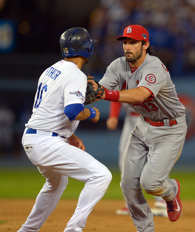 . The Cardinals\' Matt Carpenter chases down the Dodgers\' Andre Ethier and tags him out for a double play in the 9th during game 4 of the NLCS at Dodger Stadium Tuesday, October 15, 2013. The Cardinals defeated the Dodgers 4-2. (Photo by Andy Holzman/Los Angeles Daily News)