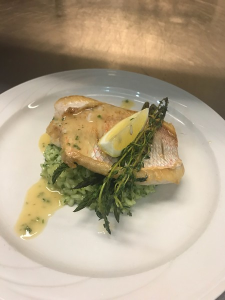 Seared Snapper with lemon thyme butter, served with pesto risotto and grilled balsamic asparagus.