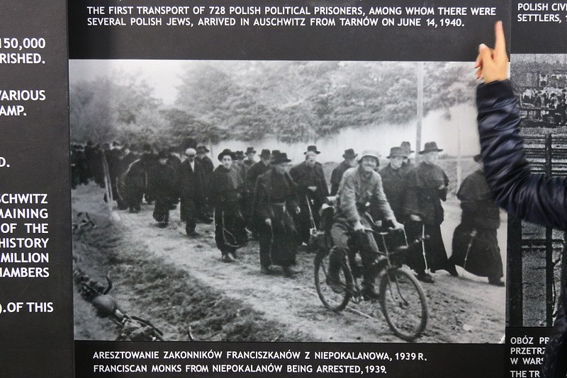 Period photo of a group of Franciscan Monks after their arrest as they are moved to a control area for shipment to a camp. Most religious figures were arrested for harboring Jews.