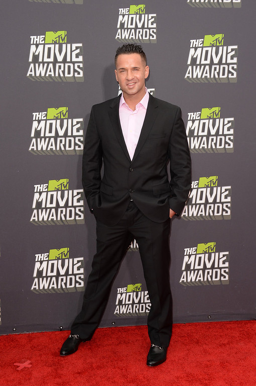 """. TV personality Mike \""""The Situation\"""" Sorrentino arrives at the 2013 MTV Movie Awards at Sony Pictures Studios on April 14, 2013 in Culver City, California.  (Photo by Jason Merritt/Getty Images)"""