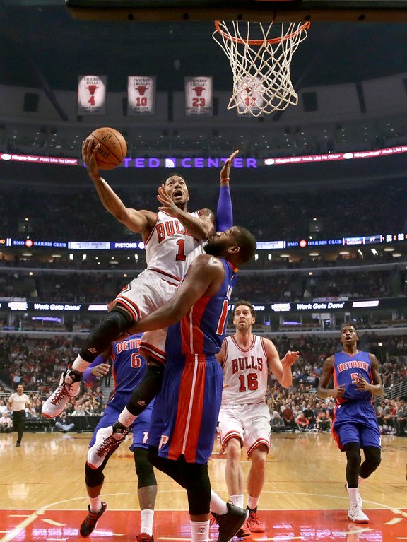 . Chicago Bulls guard Derrick Rose (1) shoots over Detroit Pistons forward Greg Monroe, as Pau Gasol (16) and Kentavious Caldwell-Pope watch, during the first half of an NBA basketball game Monday, Nov. 10, 2014, in Chicago. (AP Photo/Charles Rex Arbogast)