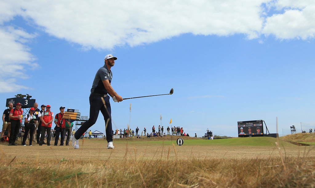 . Dustin Johnson of the US plays a shot off the 4th tee during the first round of the British Open Golf Championship in Carnoustie, Scotland, Thursday July 19, 2018. (AP Photo/Jon Super)
