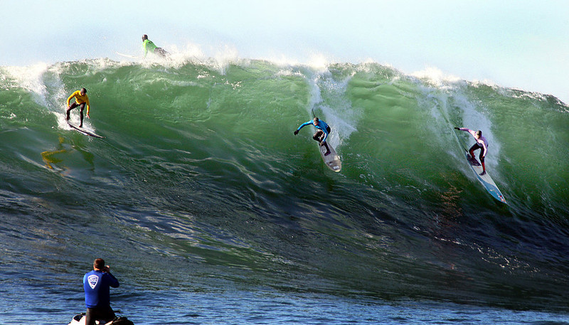 . Alex Martins, Greg Long and Peter Mel of Santa Cruz scramble to catch the same wave during the final heat of the Mavericks Invitational Sunday.  Mel, a veteran of the big wave contests, won the event for the first time.  (Dan Coyro/Sentinel)