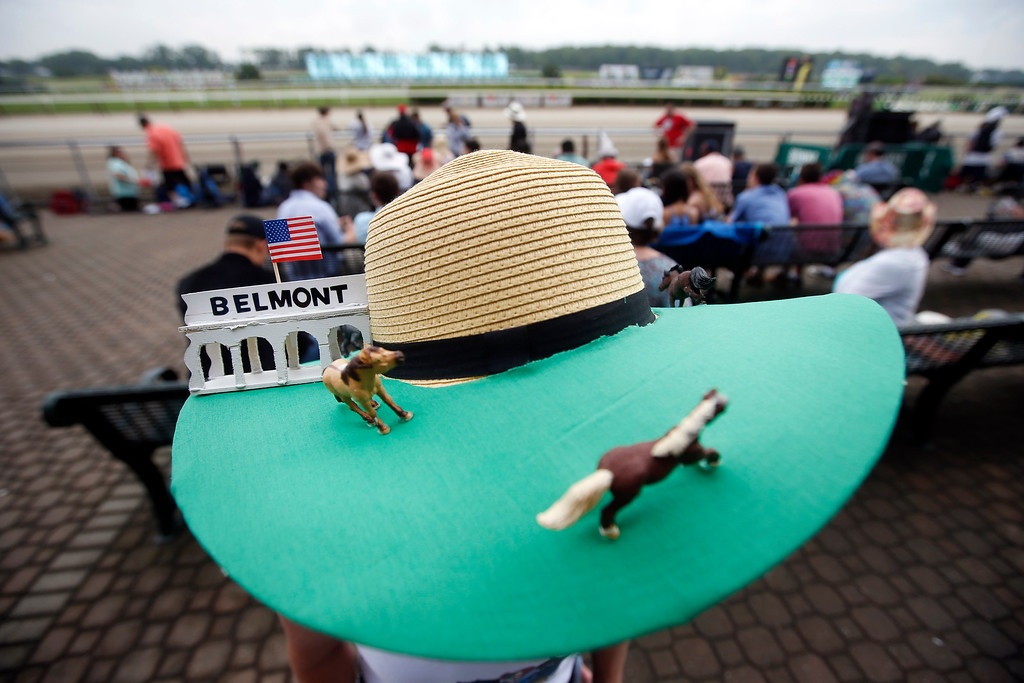 . Donna Zirbes-Steinmetz, of Lindenhurst, N.Y., wears a race-themed hat before the 147th running of the Belmont Stakes horse race at Belmont Park, Saturday, June 8, 2015, in Elmont, N.Y.  American Pharoah will try for a Triple Crown when he runs in Saturday\'s race.(AP Photo/Jason DeCrow)