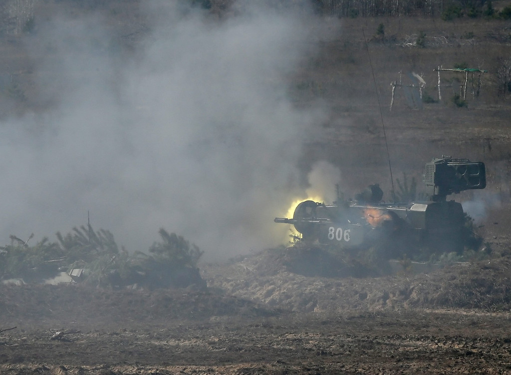 . A Ukrainian \'Tunguska\' combined gun and missile air defense system fires during a military drill at the military shooting range called Goncharivka, 120 kilometers north-east from Kiev, Ukraine, 14 March 2014. Tanks, helicopters, artillery and paratroopers took part at a complex military exercise, inspected by the Ukraine\'s acting President Olekasndr Turchynov (not pictured), two days before the Crimean referendum. Ukrainian parliament on 13 March backed a decision to create a new National Guard of 60,000 volunteers, in order to supplement its conventional army forces estimated at 130,000 soldiers.  EPA/SERGEY DOLZHENKO