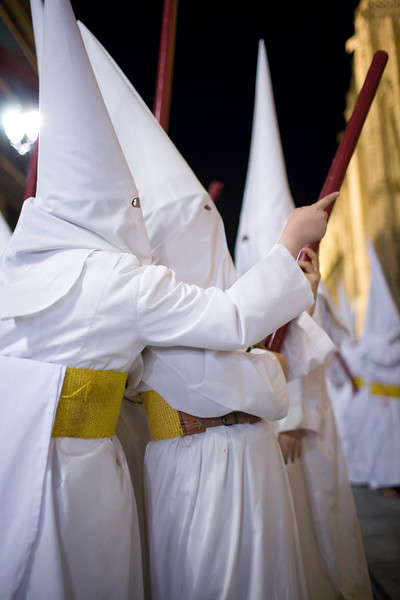 Young penitents talking, Holy Week, Seville, Spain
