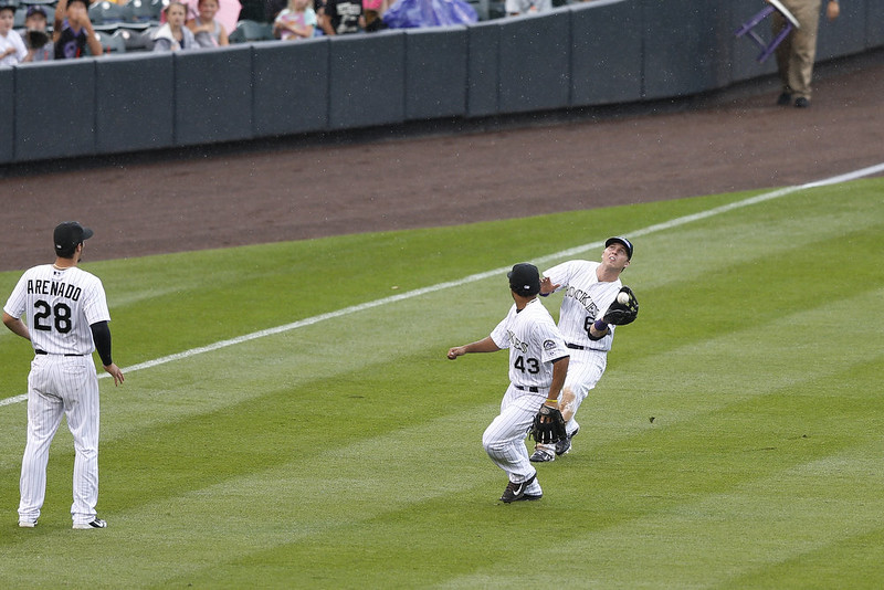 . Corey Dickerson #6 of the Colorado Rockies makes a catch in left field behind Rafael Ynoa #43 during the game against the San Diego Padres at Coors Field on September 7, 2014 in Denver, Colorado. The Rockies won 6-0. (Photo by Joe Robbins/Getty Images)