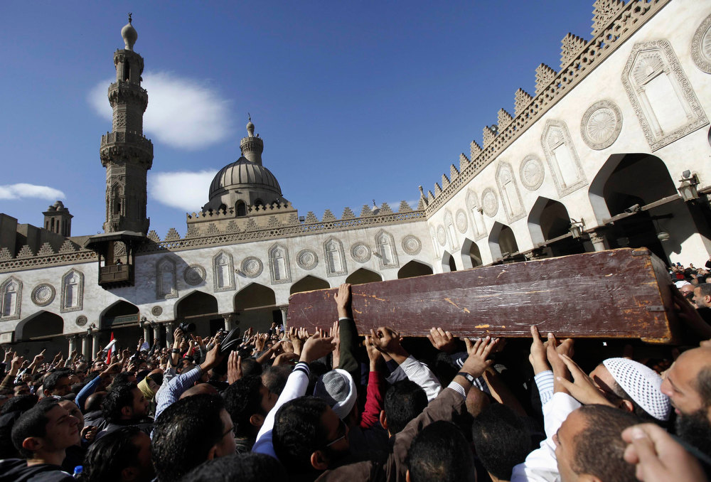 Description of . Supporters of Egyptian President Mohamed Mursi and members of the Muslim Brotherhood carry the coffin of fellow supporter Mohamed Mamdouh al-Husseini, who died in recent clashes at the presidential palace according to local media, at Al Azhar mosque in Cairo December 7, 2012. The crisis unleashed by Mursi\'s bid to wrap up Egypt\'s transition on his own terms has eroded his nation\'s faith in their nascent democracy and will complicate the already unenviable task of government. Mohamed, a supporter of Mursi, was a son of a Muslim Brotherhood leader Mamdouh al-Husseini, reported local media. REUTERS/Amr Abdallah Dalsh